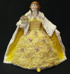 Volkstedt porcelain. I am after a yellow dress figurine.  Pin BORROWED