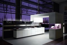 White Kitchen Design with Wooden Back Walls - +Artesio by Poggenpohl