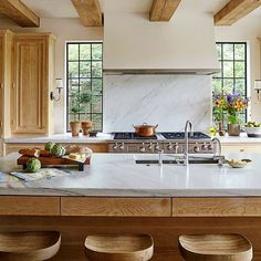 Been getting all dreamy about marble tops and white-washed oak cabinets like these from @paulbatesarchitects ...look for this to make an appearance at one of our @vocenashville projects! (Photo by @jallsopp)