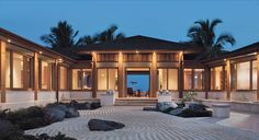 Vacation home in Hawaii organized around a Zen garden of raked coral stones. Natural materials are used all throughout. Vacation Home Ideas - ELLE DECOR
