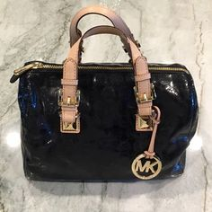 Michael Kors purse Patent leather black authentic Michael Kors purse. In perfect condition! Original duster bag included. Michael Kors Bags Satchels