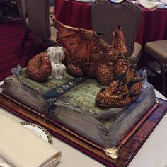 This is a mighty grooms cake made by Tiffany Flanagan and uses Krispy treats as a clever way to sculpt the dragon.