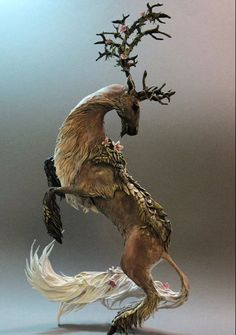 """wryer: """" Ellen June is an artist from Canada who uses air-drying clay, wire, glaze and acrylic paint to create these amazingly beautiful sculptures of fantasy animals. Each sculpture is handmade and. Magical Creatures, Fantasy Creatures, 3d Modelle, Deer Art, Sculpture Clay, Animal Sculptures, Photomontage, Fantastic Beasts, Amazing Art"""