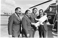 Developing the Space Shuttle Program  Nixon holds a model of the Space Shuttle and its transport plane while standing near the Presidential helicopter with Governor Claude Kirk and Congressman Bill Cramer at the St. Petersburg Airport (St. Petersburg, Florida). 10/28/1970.  -from the Nixon Library