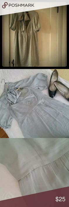 """Original Penguin grey silk dress Grey silk bowtie-collar party dress. Perfect for a wedding or cocktail party. Nice darting at chest, hidden side zipper. 38"""" at waist, 28"""" from armpit to bottom of skirt. Please note: this dress is previously loved and has some gentle wear, including a few minor thread pulls, tiny spots at chest, and some stitching coming out at waist. Please see photos and ask any necessary questions! Original Penguin Dresses Mini"""