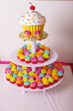 I made this giant cupcake and mini cupcake tower to go with the sweet-shoppe themed cake (adapted from the Wilton yearbook cake) for my daughters third birthday.