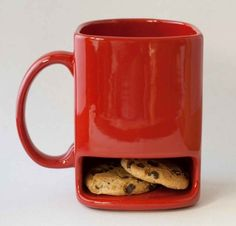 I want one!!!   A milk mug with a cookie pocket! Might not be big enough for my oreos, though... haha