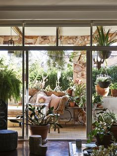 The Sydney home of Dion Antony, Anna Feller and Family. Their garden oasis adjoining the living room is always a favourite spot for a long lunch. Cushions by Pony Rider. Photo – Eve Wilson. Production – Lucy Feagins/The Design Files.TDF Bellvue20248