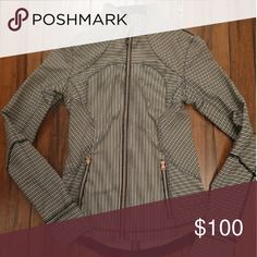 Rare lululemon jacket Navy Mogave striped forme cuffins jacket. I found one really small pull on the stomach. No other flaws.  Rose gold zipper and pulls. Stretchy material. lululemon athletica Tops
