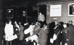 27 November 1941, early morning: photographs depicting the first deportation of Jews from Würzburg.        On November 27th, 1941, Jews from Würzburg, Germany were deported for the first time to the east. This deportation of 212 Jews from Würzburg was documented by German policemen, and the photos were arranged in an album. To see the album, click this pin.