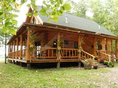 Love the spacious porch on this log cabin.....