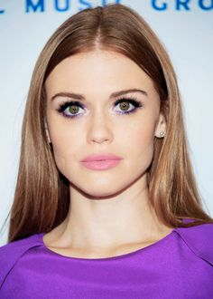 Purple eyeliner on Holland Roden. Glad I'm not the only person on earth with freakishly big green eyes.