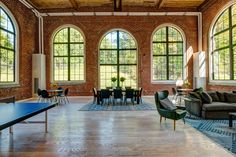 The thoughtful adaptive reuse and restoration of the historic building structure features 57 oversized, modern lofts market-rate units Rive Nord, Outdoor Baths, La Rive, Adaptive Reuse, Rustic Colors, Building Structure, Historical Architecture, Exposed Brick, Cladding