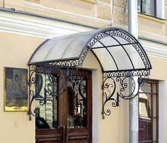 Wrought Iron Awning Calgary: Starburn Ironworks Calgary, Alberta, Canada Source by zizazoum Wrought Iron Doors, Arched Doors, Eisen Pergola, Door Design, House Design, Front Door Canopy, Porch Awning, Window Awnings, Balcony Railing