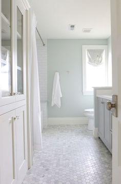 Tile/wall color idea --- Sherwin Williams Sea Salt in a bathroom with marble hexagon tile floor, natural light and white subway tile Bathroom Floor Tiles, Bathroom Renos, Tiled Bathrooms, Paint Bathroom, Marble Bathroom Floor, Bathroom Wall Colors, Small Bathrooms, Wainscoting Bathroom, Luxury Bathrooms