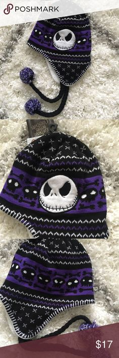 NWT Jack Skellington Purple Hat New with tags! Purple Jack Skellington sweater print hat with pom pom strings Spencer's Accessories Hats
