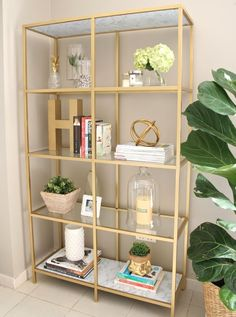 Ikea VITTSJÖ shelving unit transformed into a glorious gold book shelf. - Ikea VITTSJÖ shelving unit transformed into a glorious gold book shelf. Gold Bookshelf, Bookshelf Styling, Gold Shelves, Bookshelf Decorating, Glass Shelves, Glass Bookcase, Ladder Bookcase, Bookcases, Apartment Bookshelves