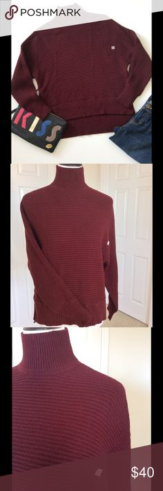 """🆕 Loft Cozy Maroon Sweater New W/ Tags Stay warm in style with this gorgeous sweater. High/low hemline; turtleneck; dolman sleeves. 55% cotton 21% nylon 19% rayon 5% camel. Hand wash. New with tags. Bust about 39"""" waist 38"""" length from shoulder front 21""""; back 25"""". Jeans & wristlet listed separately  🎀Bundle discount  ⭐️5 star rated Suggested User 🚭Smoke free home 🚫No trades please  😍 Thank you for shopping with me. Please ask all questions before purchase LOFT Sweaters Cowl…"""