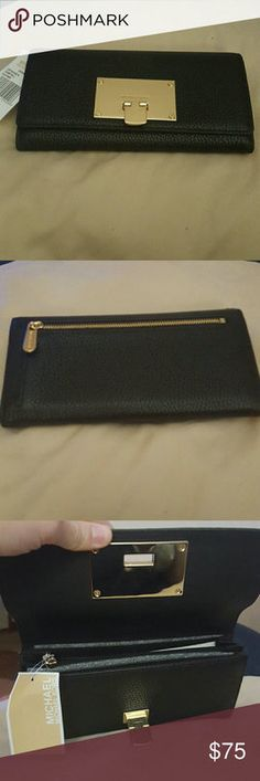 Michael Kors wristlet Tiny shiny gray Michael Kors wristlet. Barley used can be used as a money purse or credit card purse. Still a pretty gem ! Michael Kors Bags Clutches  Wristlets
