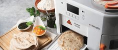 Rotimatic is the world's first fully integrated solution that measures, mixes, kneads, flattens, cooks, puffs and delights. All in one! LOAD fresh Ingredients.