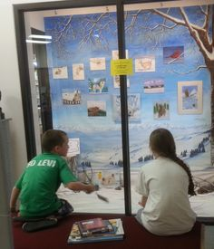 Levi and Annabelle enjoy the Art Club display as they wait for Mom.
