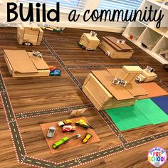 Build a community with road tape and FREE community signs for the blocks center!