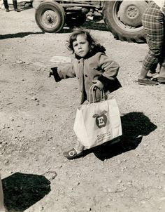 A young girl carrying a bag of apples at Eckert's Apple Farm in Grafton, Illinois circa 1970 | Missouri History Museum #food #shopping #farm
