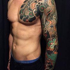 Japanese tattoo sleeve by @horimatsu_bunshin.  #japaneseink #japanesetattoo #irezumi #tebori #colortattoo #colorfultattoo #cooltattoo #largetattoo #armtattoo #chesttattoo #tattoosleeve #dragontattoo #flowertattoo #wavetattoo #naturetattoo