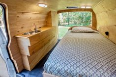 This clean, pared-down and solar-powered van conversion hides a lot of ideas for clever storage and ergonomics.