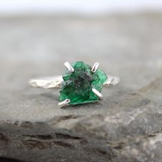 typically the uncut stone rings I have seen just don't do it for me but there is something about this uncut emerald that is absolutely breathtaking
