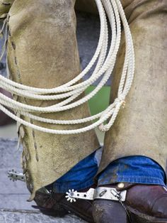 Rope, chaps, spurs, boots, and wranglers make me smile.