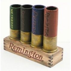 Remington shotgun shell toothbrush holder. - Would look so good in our camo/hunting masterbedroom for somthing other than toothbrushes of course.