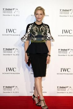 Cate Blanchett posed on the red carpet in a black peplum skirt at the IWC watches gala dinner during the 9th Dubai International Film Festival at 'Royal Mirage' hotel, near Dubai on 10 December 2012.