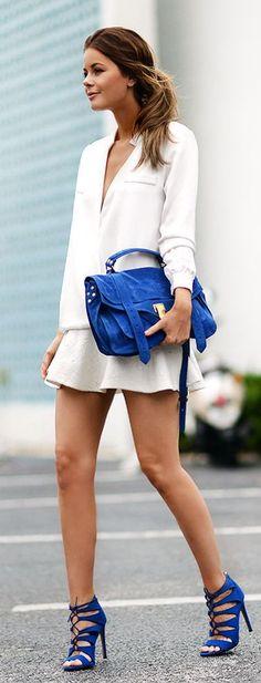 all white + cobalt blue accessories.
