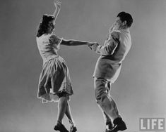 Kaye Popp & Stanley Catron demonstrating a step of The Lindy Hop (Photo by Gjon Mili/The LIFE Picture Collection/Getty Images)