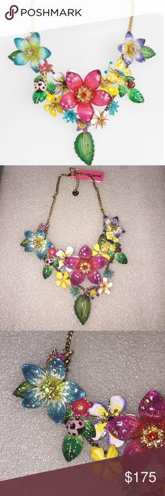 Betsey Johnson necklace Selling to buy Betsey pieces I need. This is from the Hawaiian collection. The necklace is gold tone. The gorgeous charms include several shapes and sizes of flowers, butterfly, ladybug, and leaves. NWT super rare Betsey Johnson Jewelry Necklaces