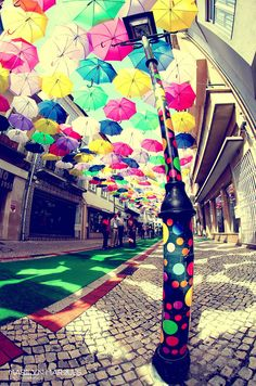 Colorful floating umbrellas, part of the Agueda Festival in Portugal