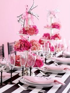 Pink, black and white bridal shower. Flowers on dessert tier plates.