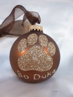Dog Paw Print Glitter Ornament - Personalized Pet Doggie Glass Ball Ornament - Chocolate Brown Ornament. $15.00, via Etsy.