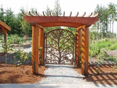 Doesn't this look grand? This is our custom Tree of Life iron gate installed with a massive arbor. We can plasma cut any design!
