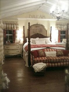 French Country Cottage bedroom with redish accents. Lovely!
