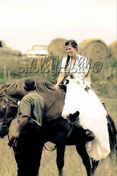 definitely want a picture of me in my wedding dress on a horse