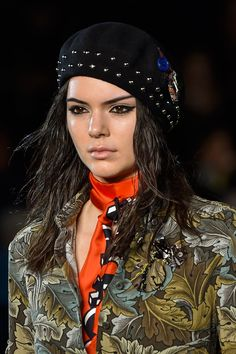 Kendall Jenner at Marc by Marc Jacobs made a case for scrunching your hair making a mighty return. Hair stylist Guido Palau coated her locks in Redken Full Effects 04 Mousse and scrunched it in, old school-style! The makeup was fiercely grunge.   - Cosmopolitan.co.uk
