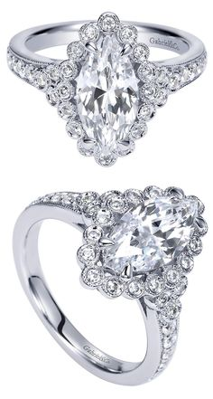 A 14k White Gold Victorian Halo Engagement Ring with a Marquise Center Stone.
