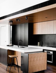 Our Vivid Slimline Sink Mixer in Matte Black is a standout in this stunning kitchen space. Simply perfection with all the timber finishes and grains 💗⠀  To view more Phoenix Products follow the link >>>> http://www.phoenixtapware.com.au/