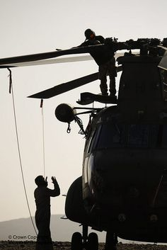 Royal Air Force technicians work on a Chinook helicopter during a pre-Afghanistan exercise.