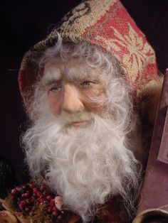 What in the world do you suppose has so captured my heart about this fellow?   DeCamp. This Santa sold 3/27/14 for $355.00.