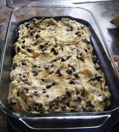 Lazy Cookie Cake Cookies: 1 box yellow or white cake mix 2 eggs beaten 5 T melted butter 2 C mini chocolate chips Mix together, refrain from eating it raw, put in a greased 913 pan and bake at 350 for 20 min.