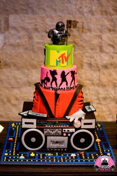 We went Back To The Future for this totally radical bodacious towering cake! Each tier was a special request from the client, & the silhouette tier matched the event T-shirts. The bottom tier is an Boom Box, complete with cassettes. 80s Birthday Parties, Themed Birthday Cakes, 80s Party, Skate Party, Themed Cakes, Birthday Party Themes, Sweet 16 Birthday, 80th Birthday, Bolo Pac Man