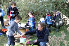 Can you spot what everyone is creating in the mud kitchen? Photo by Ric Mellis